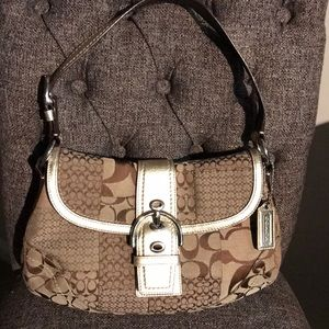 Coach brown and gold flap front handbag